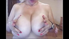 chubby blonde shows off massive tits