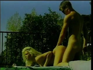 Hot blonde with nice tits sucks cock outdoors then bends over for doggy-style