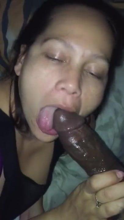 Mixed asian MILF sucking BBC