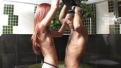 Redheaded a-cup tranny blows dude then lowers his ass onto dude's cock