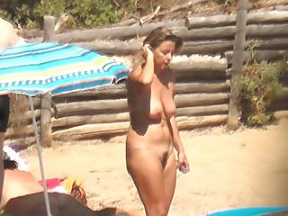 naked blonde milf undressing on beach