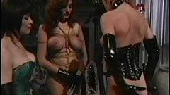Asian BDSM mistress punishes her slutty slaves
