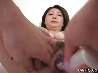 Gorgeous Japanese woman munches and rides on a hard boner
