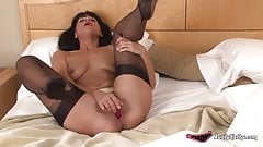 Big ass milf Kathy masturbating under the covers