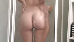Girl playing in the shower with her tits pussy and ass