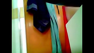 Woman drying herself and dressing panties