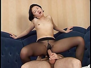 Asian babe gets cum on her black Pantyhose