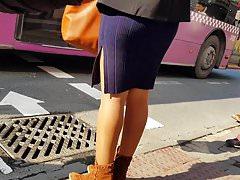 Girl in shiny tan pantyhose and mini dress