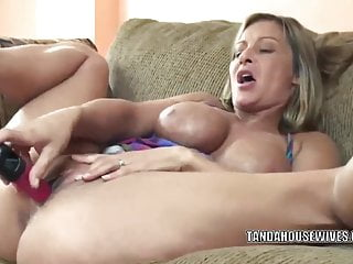 Mature slut Leeanna Heart lifts her skirt to fuck a dildo