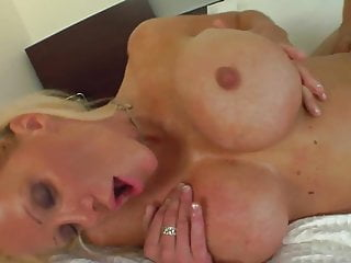 Blonde milf with fake boobs fucked by young boy