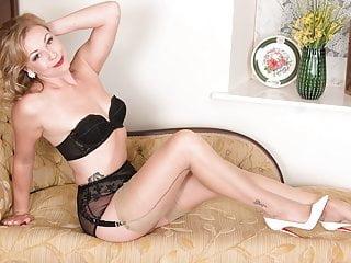 Tasty Blonde Frigs Herself Off In Nylons Garters High Heels