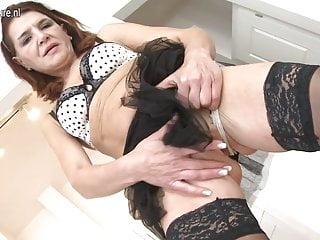 Mature mom fucks herself on a kitchen
