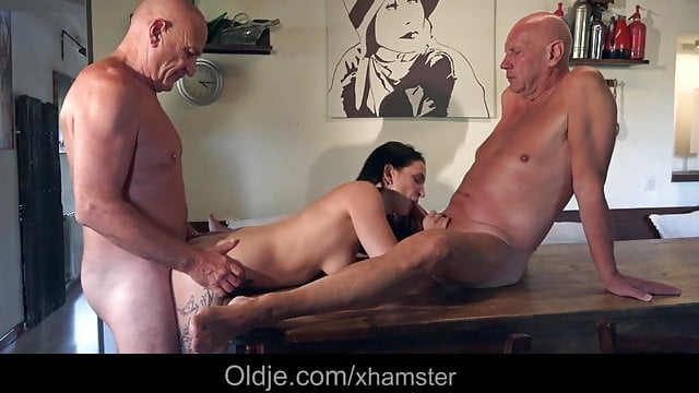 Preview 1 of Young babe flirting and fucking two old guys in the kitchen