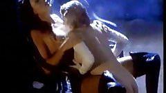 Monique Parent and Glitter in lesbo dominatrix action