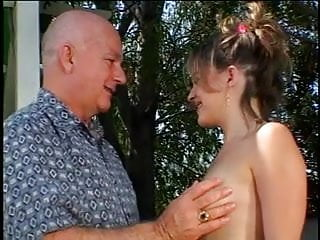 Mature male gets cock sucked by blonde slut outdoors