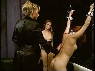 Stern mistress overlooking 2 hot slaves in BDSM action