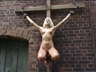 Cross crucified on naked women