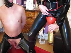 rubber mistress uses her piss on latex slave