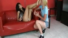 Submissive blond girl worships mistress feet