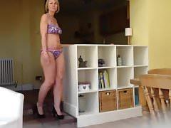 Shy British milf in bikini posing