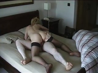 Blonde nympho grinds her tight pussy on his hard cock