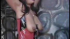 Sexy dominatrix bends two sluts over for use