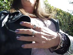 Tranny sitting on a parkbench masturbating her clitty