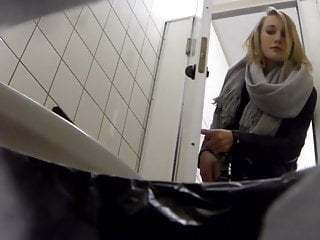 Student Goes to Toilet in College and Shows Her Red Thong