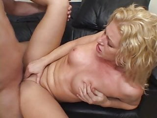 Busty blonde has wild sex with her boyfriend on a couch