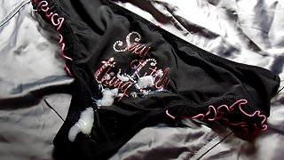Cum on shiny black and pink panties