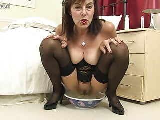 Kinky mother loves pissing bananas and buttplugs