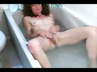 Hairy old woman playing with her pussy