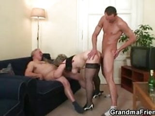 She warms up her cunt before two cocks