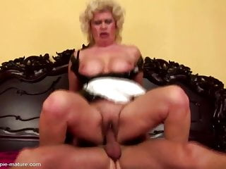 Young boy fucks and cums into granny's old cunt