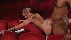 black dick fuck blonde woman in a theatre