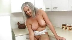GRAY HAIRED APRIL THOMAS STRIP IN THE KITCHEN