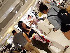 Candid voyeur Asian girl showing ass while shopping