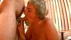 Big Breasted Granny Sucks and Fucks
