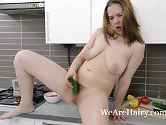 Lina masturbates with a cucumber to orgasm