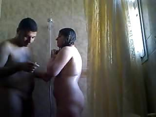 Arab couple play in the shower