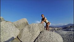 Climbing a Rock in a short Dress's Thumb