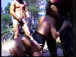 Naked big breasted woman doing handstand