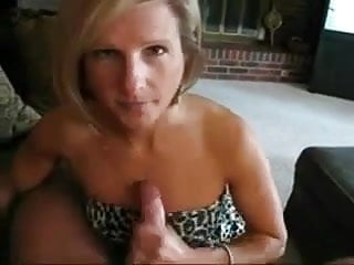 Blonde cougar sucking younger cock
