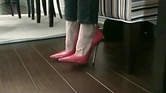 pink heels on a chair