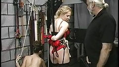 Guy and brunette punish sexy blonde in dungeon and red lingerie