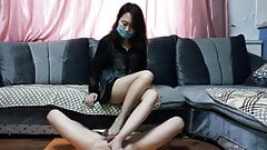 Dominant Chinese Mistress Footjob's Thumb