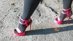Lady L walking with sexy red high heels.