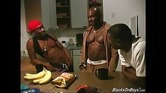 Three black dudes sharing a muscular guy