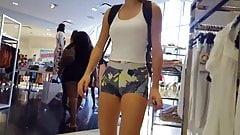 Candid voyeur teen shopping in spandex shorts hot