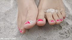 Feet and Toes in the Sand at the Beach